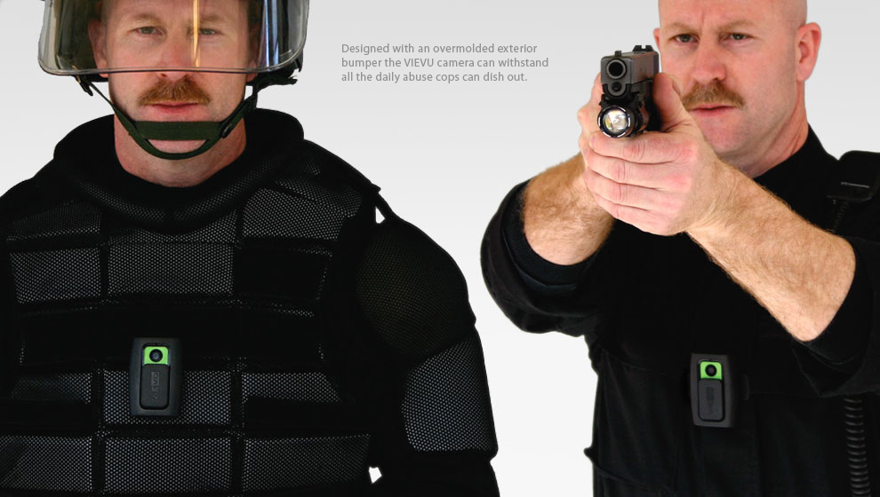 Police officers wearing video cameras on chest